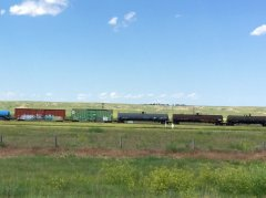 Boxcars and tanks passing by on the rail tracks